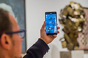 Jonathan Yeo shows how he saw his sculpture, Homage to Paolozzi, in VR - a collaboration with Google Arts & Culture to create the first physical free-standing sculpture in metal made using the Virtual Reality program Tilt Brush - From Life a new exhibition at the Royal Academy of Arts. It runs from 11 December 2017 – 11 March 2018.