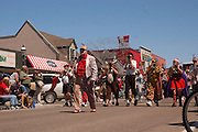 The crowd favorite Scottville Clown Band from Scottville, Michigan make their way up Central Avenue during the Memorial Weekend Grand Parade in Mackinaw City, Michigan.