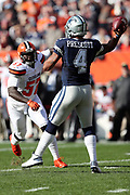 Dallas Cowboys quarterback Dak Prescott (4) throws a pass off his back foot while pressured by Cleveland Browns outside linebacker Cam Johnson (57) during the 2016 NFL week 9 regular season football game against the Cleveland Browns on Sunday, Nov. 6, 2016 in Cleveland. The Cowboys won the game 35-10. (©Paul Anthony Spinelli)