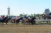 Tonalist, ridden by jockey Joel Rosario, takes the 146th Belmont Stakes, with California Chrome following in fourth, Saturday, June 7, 2014, at Belmont Park in New York.  Longines, the Swiss watchmaker known for its elegant timepieces, is the Official Watch and Timekeeper of the 146th running of the Belmont Stakes. (Photo by Diane Bondareff/Invision for Longines/AP Images)