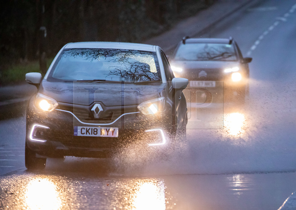 © Licensed to London News Pictures. 15/02/2020. London, UK. Heavy surface water caused problems for traffic around Barnes this afternoon as Storm Dennis hits London and the South East with high winds and heavy rain forecast for the weekend. Photo credit: Alex Lentati/LNP