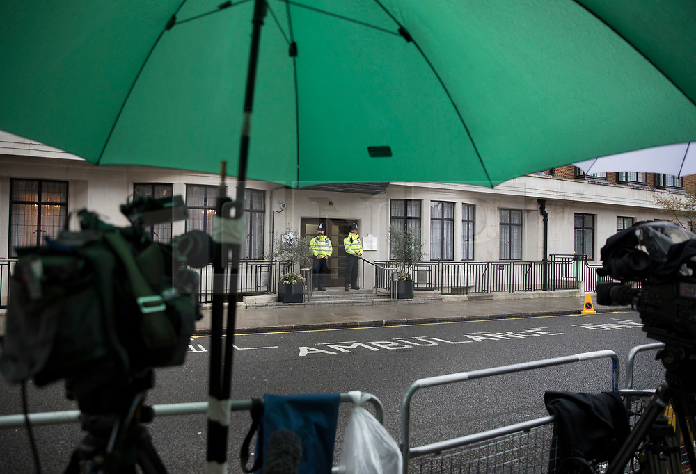 © Licensed to London News Pictures. 08/04/2018. London, UK. Television cameras are kept dry under a large green umbrella as The Duke of Edinburgh spends a 5th day in the King Edward VII Hospital as he recovers from a hip operation. Photo credit: Peter Macdiarmid/LNP