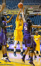 West Virginia Mountaineers forward Averee Fields (5) takes a jump shot against the TCU Horned Frogs at the WVU Coliseum.