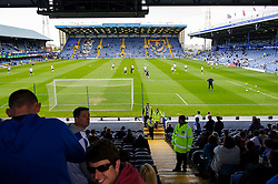 A general view from the away stand as Bristol Rovers players warm up before the match - Photo mandatory by-line: Rogan Thomson/JMP - 07966 386802 - 19/04/2014 - SPORT - FOOTBALL - Fratton Park, Portsmouth - Portsmouth FC v Bristol Rovers - Sky Bet Football League 2.