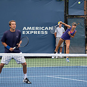 August 23, 2014, New Haven, CT:<br /> Jacqueline Cako and Joel Kielbowicz play during the US Open National Playoffs mixed doubles finals against Ena and Shuhei Shibahara on day nine of the 2014 Connecticut Open at the Yale University Tennis Center in New Haven, Connecticut Saturday, August 23, 2014.<br /> (Photo by Billie Weiss/Connecticut Open)