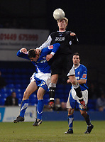Photo: Ashley Pickering.<br /> Ipswich Town v Swansea City. The FA Cup. 27/01/2007.<br /> Swansea's Alan Tate (black) wins the ball from Ipswich's Owen Garvan