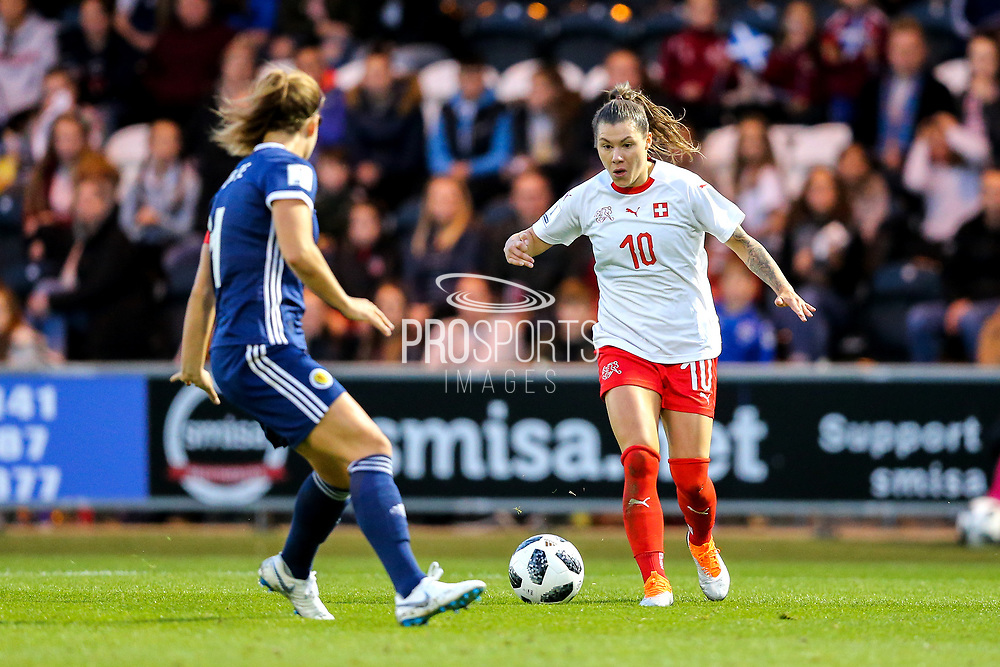Ramona Bachmann (#10) of Switzerland takes on Rachel Corsie (#4) of Scotland during the 2019 FIFA Women's World Cup UEFA Qualifier match between Scotland Women and Switzerland at the Simple Digital Arena, St Mirren, Scotland on 30 August 2018.