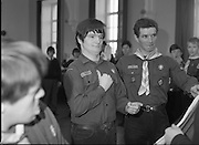 Scout Inducted Using Sign Language.   (P6)..1981..08.12.1981..12.08.1981..8th December 1981..Joe Needham, a deaf and dumb resident in Stewart's Hospital, Palmerstown, Co Dublin was enrolled into the 43rd Dublin (Palmerstown) unit of the Scouting Association of Ireland. The Chief Scout, Mr Joe McGough carried out the enrollment at the hospital. Ms Domenica Malocca, a teacher in the class for the deaf at the hospital, translated the Scout Promise into sign language during the ceremony...Picture shows Joe Needham making the scout pledge over the scout flag at the induction ceremony in Stewart's Hospital. Assistant Scout Leader, David Lane is included in the picture.