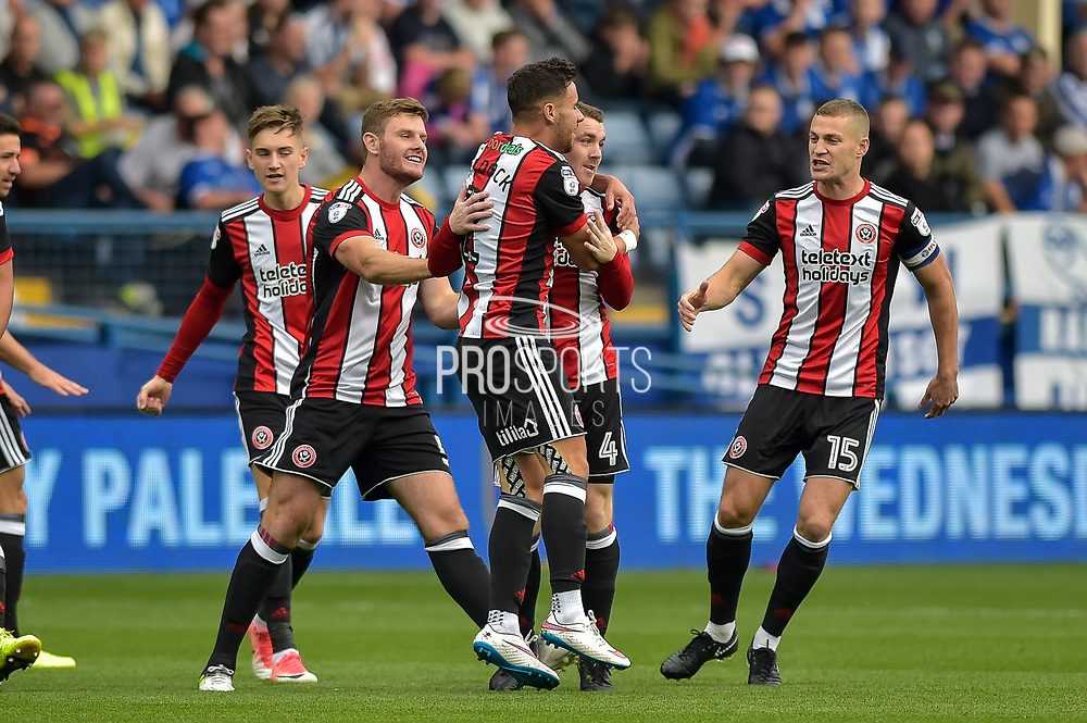 Sheffield United midfielder John Fleck (4) celebrates after scoring a goal 0-1 during the EFL Sky Bet Championship match between Sheffield Wednesday and Sheffield Utd at Hillsborough, Sheffield, England on 24 September 2017. Photo by Adam Rivers.