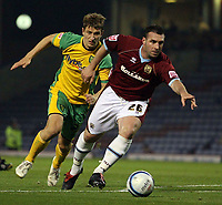 Photo: Paul Thomas.<br /> Burnley v Norwich City. Coca Cola Championship. 23/10/2007.<br /> <br /> David Unsworth (R) guides the ball away from David Strihavkal of Norwich.