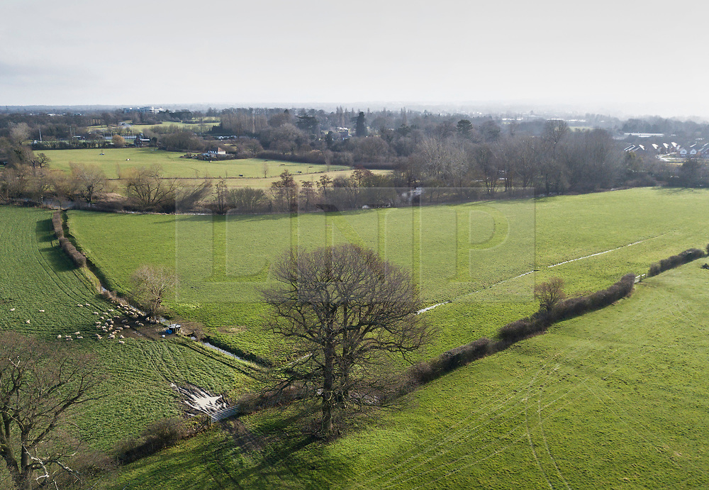 © Licensed to London News Pictures. 04/03/2018. Leatherhead, UK. Fields that were blocked with snow near Fetcham, Surrey only a few days ago are now showing more Spring like colours as the snow has melted away. Large parts of the UK are recovering from a week of sub zero temperatures and heavy snowfall, following two severe cold fronts. Photo credit: Peter Macdiarmid/LNP