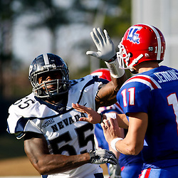 December 4, 2010; Ruston, LA, USA;  Nevada Wolf Pack defensive end Dontay Moch (55) pressures Louisiana Tech Bulldogs quarterback Ross Jenkins (11) during the first half at Joe Aillet Stadium.  Nevada defeated Louisiana Tech 35-17. Mandatory Credit: Derick E. Hingle