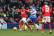 Charlton Athletic defender Zakarya Bergdich (19) goes past Reading defender Michael Hector (8) during the Sky Bet Championship match between Charlton Athletic and Reading at The Valley, London, England on 27 February 2016.