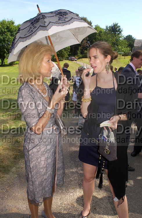Elizabeth Aitken and Victoria Aitken. Marriage of Emilia Fox to Jared Harris. St. Michael's and All Angels. Steeple. Nr. Wareham. Dorset. 16 July 2005. ONE TIME USE ONLY - DO NOT ARCHIVE  © Copyright Photograph by Dafydd Jones 66 Stockwell Park Rd. London SW9 0DA Tel 020 7733 0108 www.dafjones.com