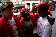 Volunteer Guardian Angels patrol the London underground in central London, an experiment in anti-crime in late-80s London. Three members of the Angels mess about at street level, outside a London underground station. The Angels are under the supervision of the organisation's creator Curtis Sliwa, who started the band of youths to help make New York a safer place, - and in London's case in an era before CCTV made travel less secure. The Guardian Angels is a non-profit international volunteer organization of unarmed citizen crime patrollers. The Guardian Angels organization was founded February 13, 1979 in New York City by Curtis Sliwa and has chapters in 15 countries and 144 cities around the world. Sliwa originally created the organization to combat widespread violence and crime on the New York City Subways.