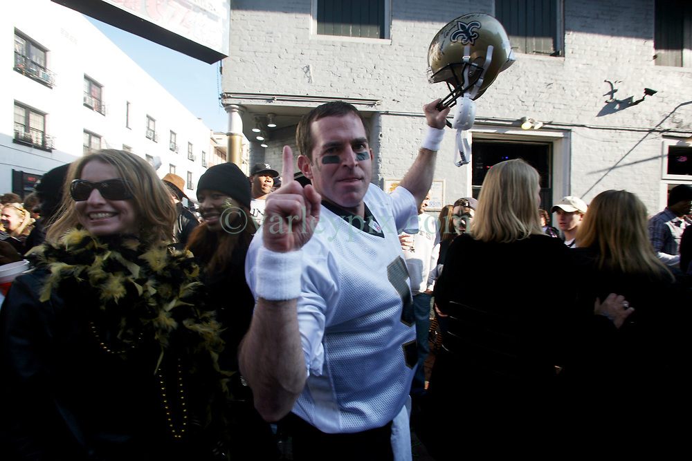 07 February 2010. New Orleans, Louisiana, USA. <br /> Super Bowl XL1V. <br /> Brian Kirn, a Drew Brees lookalike. New Orleans Saints fans gather in the French Quarter in anticipation of the big game in Miami later in the day as the home team goes head to head with the Indianapolis Colts for Super Bowl 44. <br /> Photo &copy;; Charlie Varley/varleypix.com