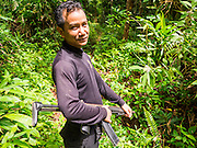 16 JUNE 2015 - CHUAP, NARATHIWAT, THAILAND:  A Thai Army Ranger cuts a trail into a Muslim insurgent camp. Thai Rangers, a paramilitary force of the Thai Army, discovered a Muslim insurgent camp in the village of Chuap, in Narathiwat province last week. Most of the insurgents in the camp escaped into the surrounding jungle, but soldiers captured two insurgents and recovered three M16 assault rifles. Two of the three rifles were stolen from the Thai Army in 2004. Investigators are still tracing the source of the third rifle. The Rangers took Thai media into the camp Tuesday. About 6,000 people have been killed in sectarian violence in Thailand's three southern provinces of Narathiwat, Pattani and Yala since a Muslim insurgency started in 2004. Attacks usually spike during religious holidays. Insurgents are fighting for more autonomy from the central government in Bangkok.      PHOTO BY JACK KURTZ