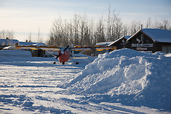 A private plane sits in the snow in Bettles, Alaska.