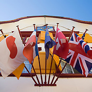 International flags hang from Hotel Cafe Adler in Appenzell, Switzerland<br />
