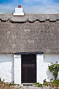 Newly whitewashed and renovated thatched cottage near Fethard-on-Sea, County Wexford, Southern Ireland