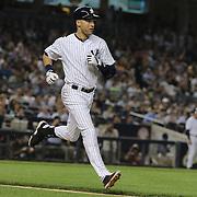 Derek Jeter, New York Yankees, runs to first base after a hit during the New York Yankees V New York Mets, Subway Series game at Yankee Stadium, The Bronx, New York. 12th May 2014. Photo Tim Clayton