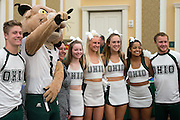 Ohio University cheerleaders and Rufus the Bobcat make their way through the 1st Annual Supplier Fair held at Ohio University's Baker Center Ballroom on September 7, 2016.