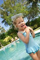 Girl (5-6) wearing snorkelling gear laughing