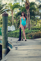 Young woman walking in swimsuit in a boating boardwalk