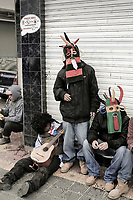 A group of tired friends rest after a night of Inti Raymi celebrations in Otavalo, Ecuador