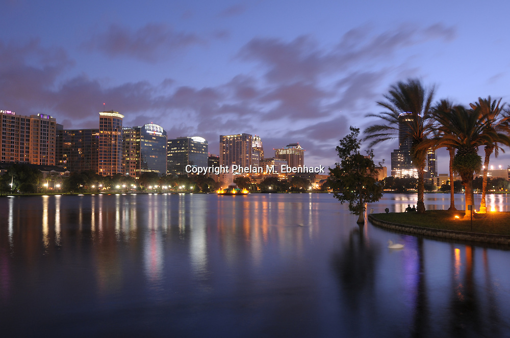 A view of the skyline of downtown Orlando, Florida, at dusk with Lake Eola in the foreground on September 24, 2008.