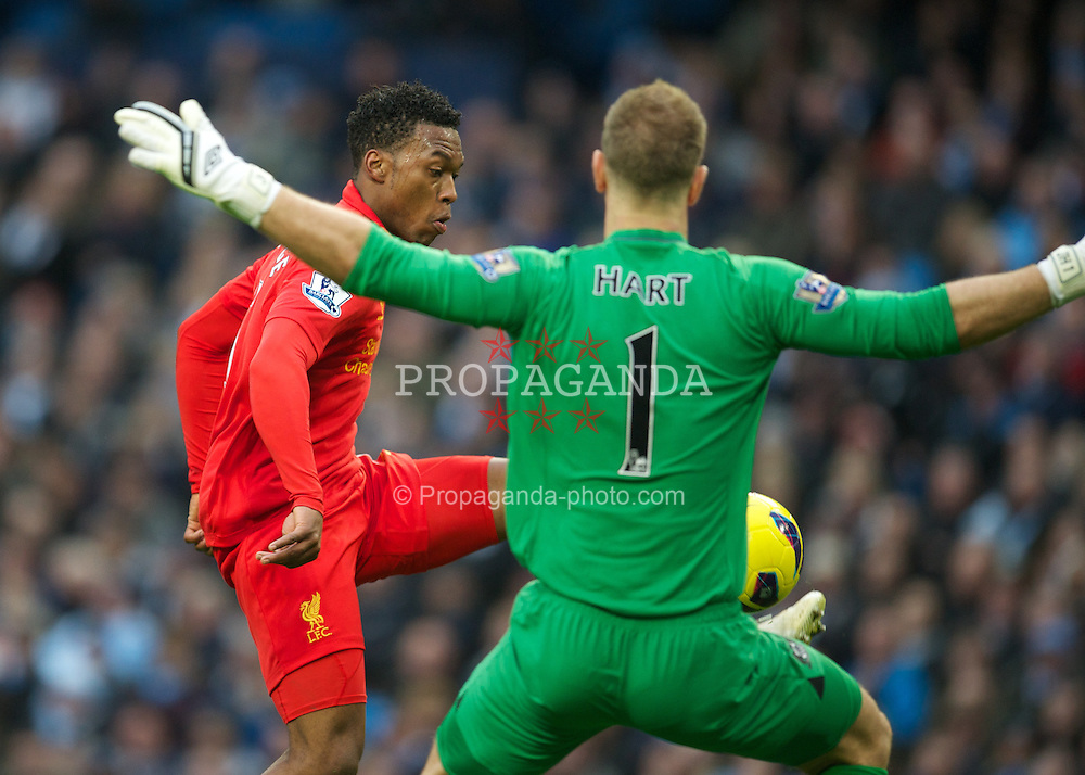 MANCHESTER, ENGLAND - Sunday, February 3, 2013: Liverpool's Daniel Sturridge in action against Manchester City's goalkeeper Joe Hart during the Premiership match at the City of Manchester Stadium. (Pic by David Rawcliffe/Propaganda)