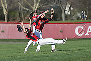 Hilton shortstop David Stirpe and left fielder Kyle Pellechia collide as they pursue a fly ball during a game against Greece Athena in Hilton on Wednesday, April 27, 2016.