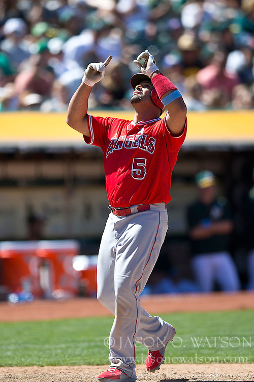 OAKLAND, CA - JUNE 21:  Albert Pujols #5 of the Los Angeles Angels of Anaheim celebrates after hitting a two run home run against the Oakland Athletics during the eighth inning at O.co Coliseum on June 21, 2015 in Oakland, California. The Oakland Athletics defeated the Los Angeles Angels of Anaheim 3-2. (Photo by Jason O. Watson/Getty Images) *** Local Caption *** Albert Pujols