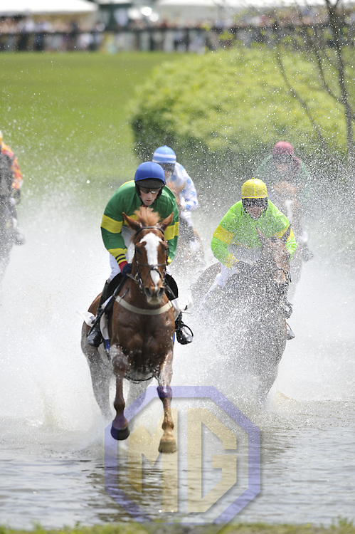 03 May 2008:  Paddy Young aboard Hidden Key leads James Slater aboard Kilbreena (R) and the other horses as they run through the water in the 2nd race of the 83rd running of the Virginia Gold Cup Races on October 20, 2007 at the Great Meadow in The Plains, Va..