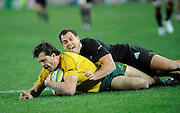 Adam Ashley Cooper gets tackled by Isreal Dagg, Rugby Championship. Australia v All Blacks at ANZ Stadium, Sydney, New Zealand. Saturday 18 August 2012. New Zealand. Photo: Richard Hood/photosport.co.nz