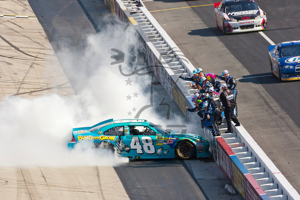 DOVER, DE - JUN 03, 2012:  Jimmie Johnson (48) holds off the rest of the field to win the FedEx 400 Benefiting Autism Speaks at the Dover International Speedway in Dover, DE.