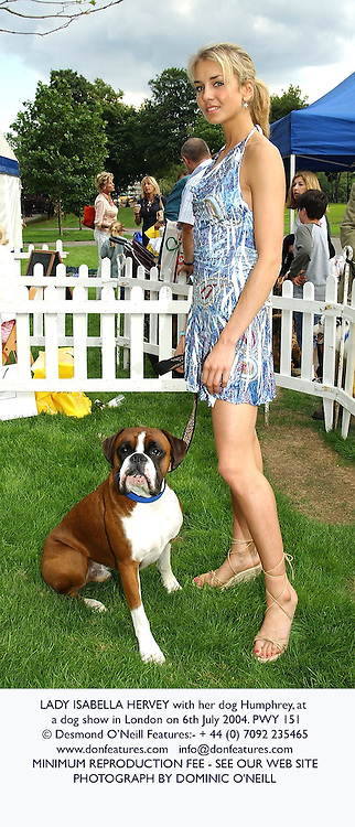 LADY ISABELLA HERVEY with her dog Humphrey, at a dog show in London on 6th July 2004.PWY 151