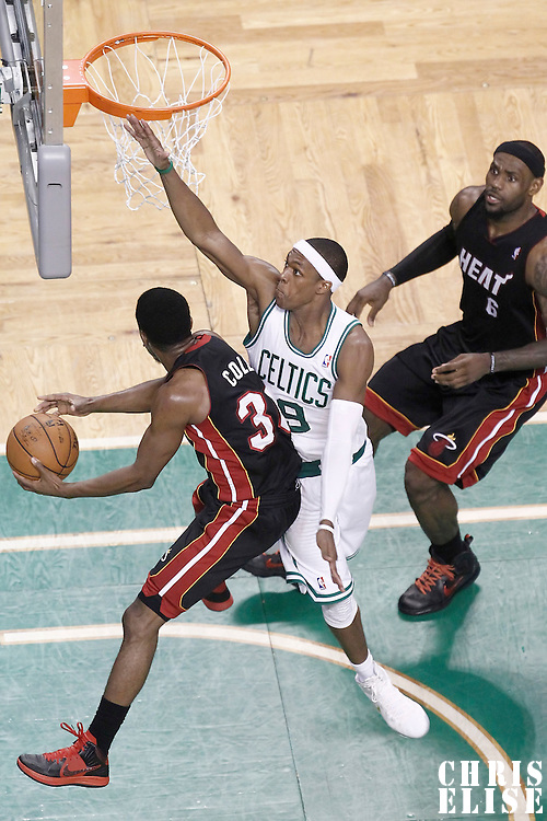 03 June 2012: Miami Heat point guard Norris Cole (30) passes the ball past Boston Celtics point guard Rajon Rondo (9) to Miami Heat small forward LeBron James (6) during the Boston Celtics 93-91 overtime victory over the Miami Heat, in Game 4 of the Eastern Conference Finals playoff series, at the TD Banknorth Garden, Boston, Massachusetts, USA.