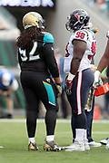 Jacksonville Jaguars rookie defensive tackle Sheldon Day (92) talks to Houston Texans rookie defensive end D.J. Reader (98) during a break in the action at the 2016 NFL week 10 regular season football game against the Houston Texans on Sunday, Nov. 13, 2016 in Jacksonville, Fla. The Texans won the game 24-21. (©Paul Anthony Spinelli)
