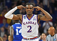 Kansas Jayhawks guard Lagerald Vick (2) celebrates a three point basket against the Seton Hall Pirates in the first half in the second round of the 2018 NCAA Tournament at INTRUST Bank Arena.