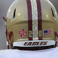 Boston College running back Tahj Kimble (20) wears a tribute sticker on his helmet during an NCAA football game between the Boston College Eagles and the UCF Knights at Bright House Networks Stadium on Saturday, September 10, 2011 in Orlando, Florida. (AP Photo/Alex Menendez)