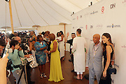 Water Mill, New York: (L-R) Television Personality Bev Smith, Television Personality Gayle King  and Music Mogul Russell Simmons attend the RUSH Philanthropic Arts Foundation 15th Annual Art For Life Benefit Gala held in the Hamptons at the Farmview Farms on July 26, 2014  in Water Mill, New York. (Terrence Jennings)