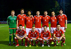BANGOR, WALES - Tuesday, November 14, 2017: Wales players line up for a team group photograph before the UEFA Under-21 European Championship Qualifying Group 8 match between Wales and Romania at the Nantporth Stadium. Back row L-R: goalkeeper Luke Pilling, captain Chris Mepham, Tyler Roberts, Cameron Coxe, Regan Poole, Jack Evans, Cian Harries. Front row L-R: Rhys Norrington-Davies, George Thomas, Harry Wilson, Thomas Harris. (Pic by Paul Greenwood/Propaganda)