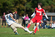 Essex's Kirk Teare (8) slides tackles CVU's Cooper O'Connell (10) during the boys soccer game between the Champlain Valley Union Redhawks and the Essex Hornets at Essex High School on Saturday mooring October 10, 2015 in Essex. (BRIAN JENKINS/For the FREE PRESS)