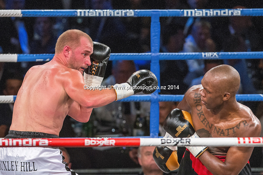 Israel`Style Bender`Adesanya (R) fights Daniel Ammann in the Mahindra Super 8 Fight Night, North Shore Events Centre, Auckland, New Zealand, Saturday, November 22, 2014. Photo: David Rowland/Photosport