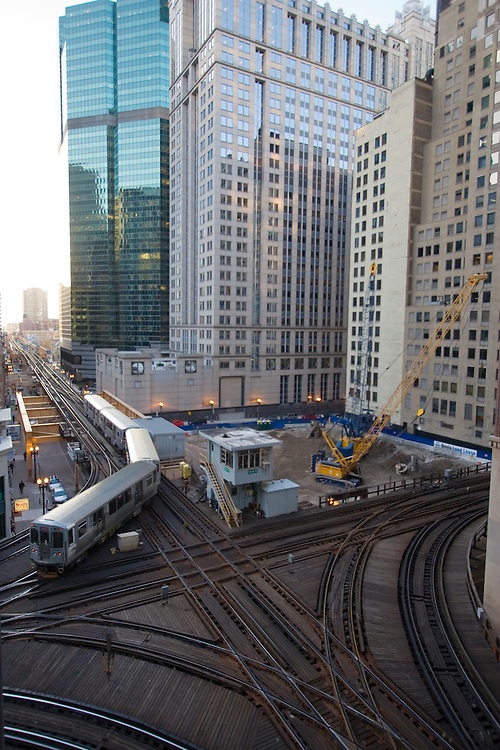 Tower 18, one of the busiest rail junctions in the world, controls this complex trackwork on the northwest corner of Chicago's Loop elevated transit system. Here a Pink Line train heads west.