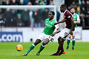 Marvin Bartley (#6) of Hibernian plays a short pass under pressure from Arnaud Djoum (#10) of Heart of Midlothian during the William Hill Scottish Cup 4th round match between Heart of Midlothian and Hibernian at Tynecastle Stadium, Gorgie, Scotland on 21 January 2018. Photo by Craig Doyle.
