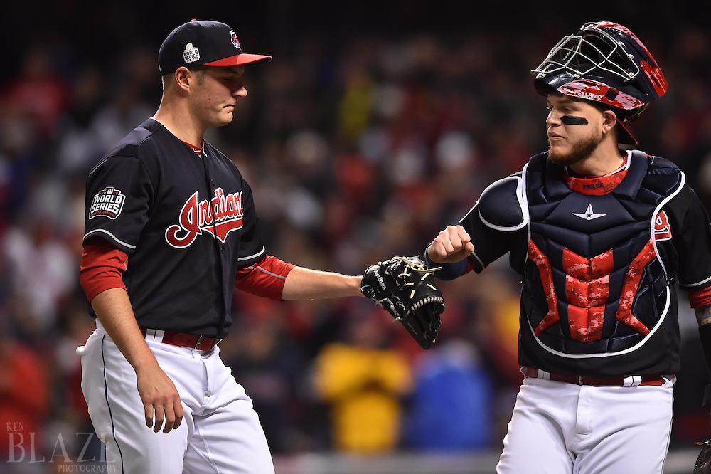 Oct 26, 2016; Cleveland, OH, USA; Cleveland Indians starting pitcher Trevor Bauer (left) greets catcher Roberto Perez after retiring the Chicago Cubs in the first inning in game two of the 2016 World Series at Progressive Field. Mandatory Credit: Ken Blaze-USA TODAY Sports