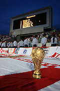 A World Cup trophy on the England flags laid out on the running track at The Central Stadium in Almaty, Kazakhstan