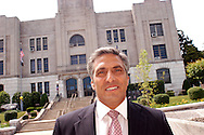 HAZLETON, PA - JUNE 21:  Mayor Lou Barletta stands in front of City Hall as he speaks about the illegal immigration ordinance June 21, 2006 in Hazleton, Pennsylvania. The Mayor introduced an ordinance that would revoke the business licenses of companies that employ illegal immigrants; impose $1,000 fines on landlords who rent to illegal immigrants; and make English the official language of the city. (Photo by William Thomas Cain/Getty Images)